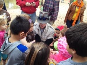 Kids gather around Joe Kenney at a recent show.