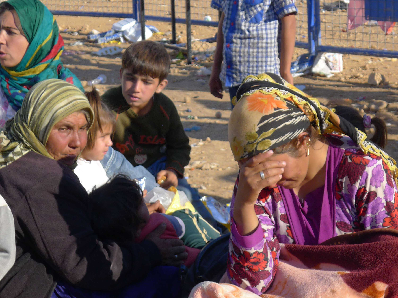 Kurdish refugees arrive in Yumurtalik, Turkey, fleeing the advances of Islamic State extremists on the north Syrian city of Kobani, on Tuesday, Sept. 30, 2014. (Roy Gutman/MCT)