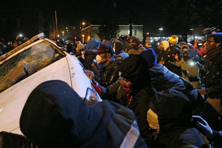 Police arrest people in the street outside the Ferguson Police Department in Ferguson, Mo., on Tuesday, Nov. 25, 2014, in the wake of the grand jury decision not to indict officer Darren Wilson in the shooting death of Ferguson teen Michael Brown. (Anthony Souffle/Chicago Tribune/TNS)