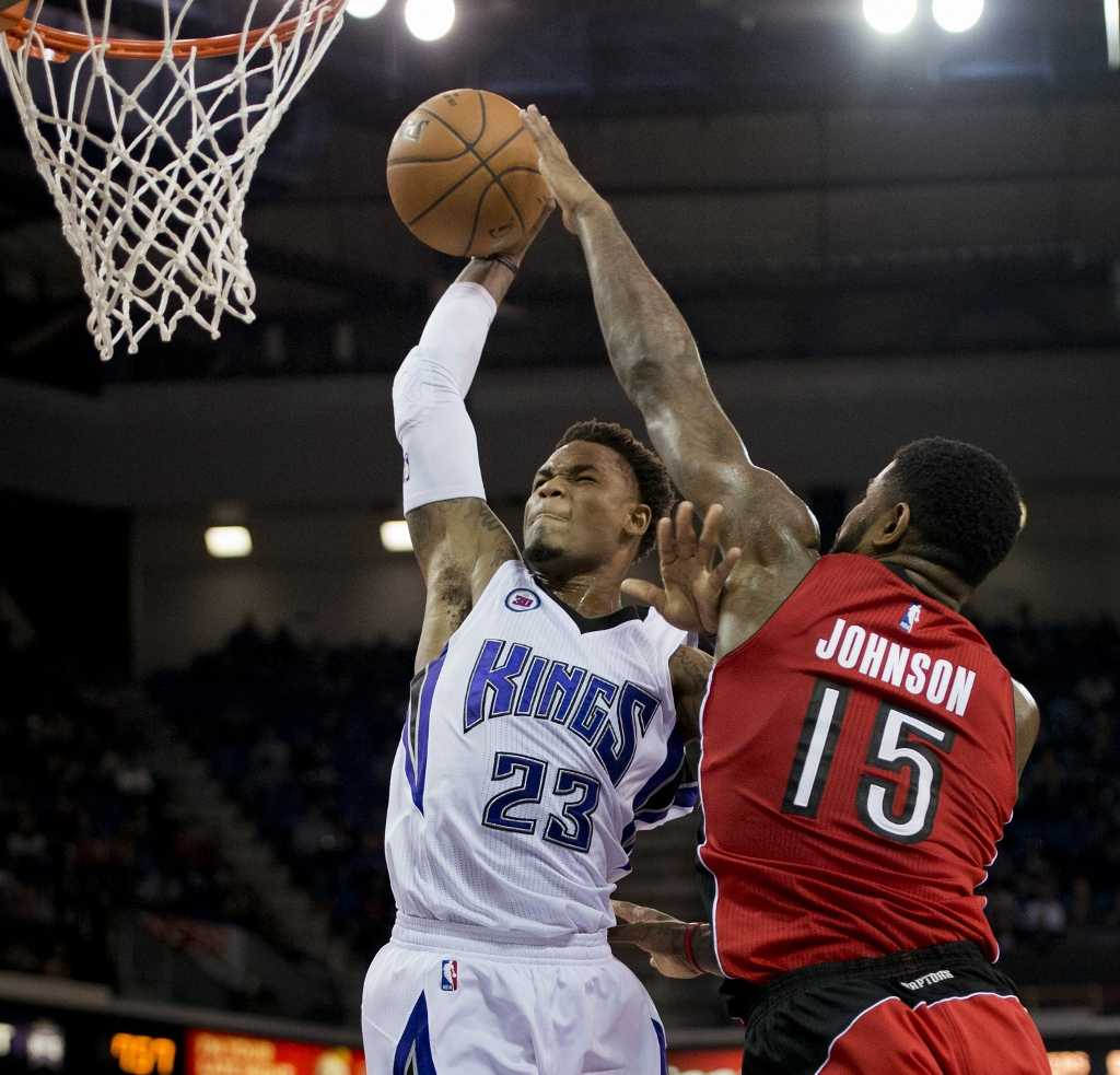 New Celtic Amir Johnson defends Ben McLemore (23) of the Sacremento Kings while playing for the Toronto Raptors in Dec 2014.