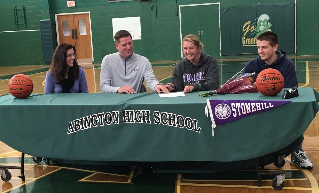 Jenny signs her letter of intent with her family by her side.