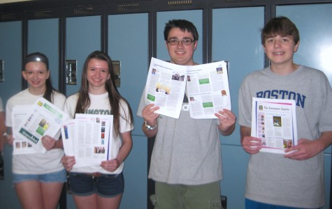 Members of the 2013-2014 Green Wave Gazette staff hold copies of the print newspaper: Caroline Bradbury (L), Nicole Bradbury, Ian MacLeod, and Jake Snyder (R).