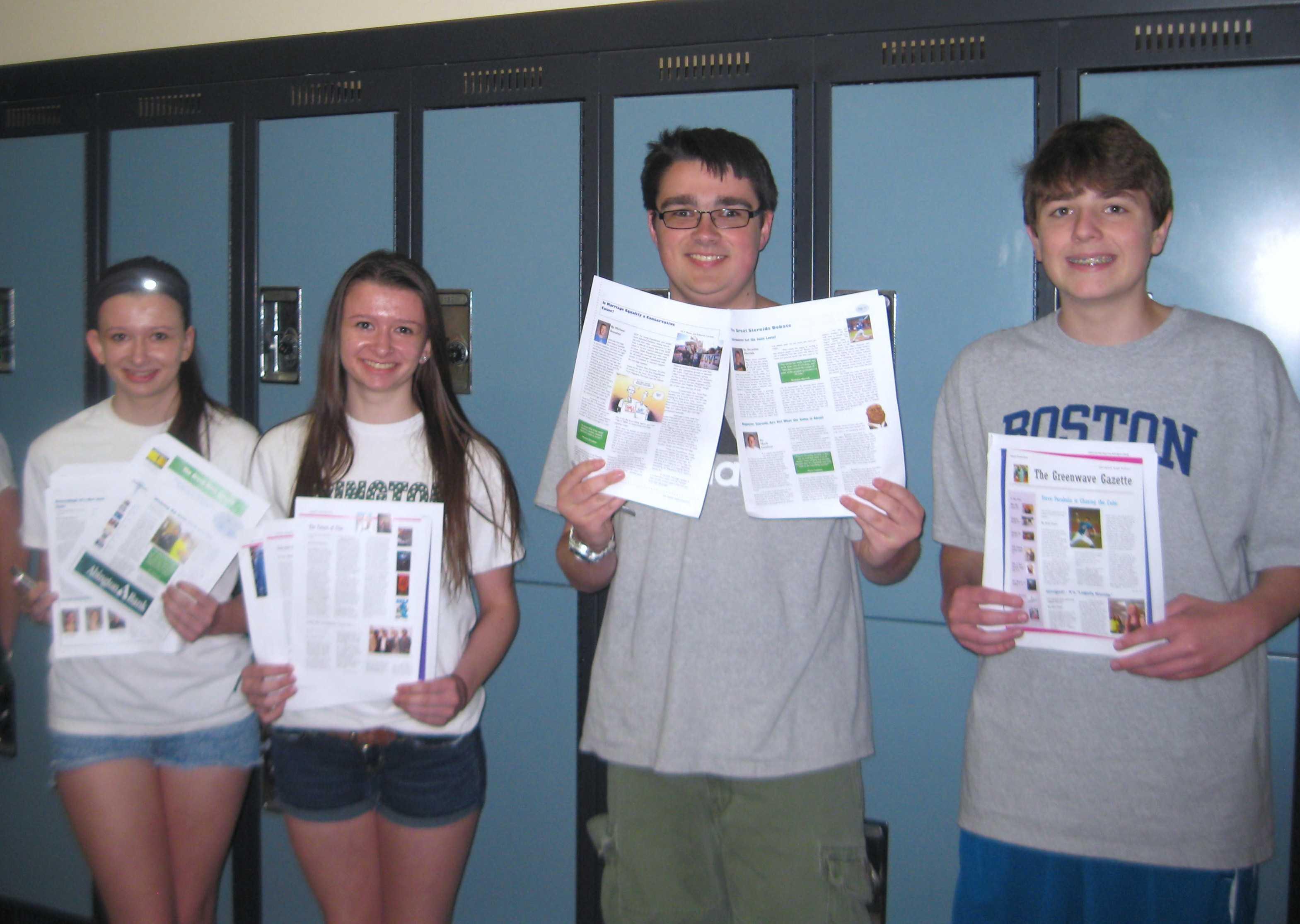 Members of the 2013-2014 Green Wave Gazette staff hold copies of the print newspaper: Caroline Bradbury (L), Nicole Bradbury, Ian MacLeod, and Jake Snyder (R).