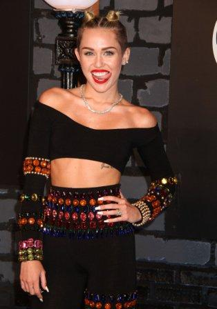 Miley Cyrus arrives at the 2013 Video Music Awards. (MCT)