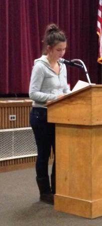 Olivia Whalen presents an original poem at the Fall Open Mic Night.