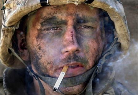Lance Cpl. James Blake Miller came to be known as The Marlboro Marine when this photo was taken of him November 9, 2004, as his unit, Charlie Company of the 1st Battalion, 8th Marine Regiment, entered Fallujah, an insurgent stronghold in Iraq's Sunni Triangle. (Luis Sinco/Los Angeles Times/MCT)