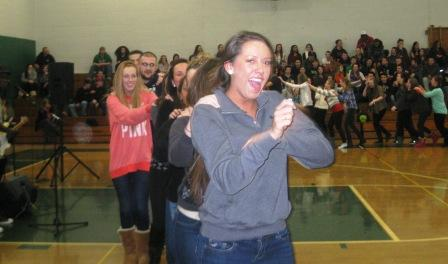 Nicole Harris leads a student Conga Line while the West African Band Mamadou performs in the Memorial Gym