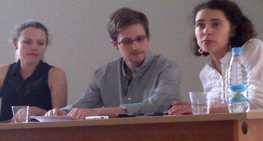 Edward Snowden, center, is shown meeting with activists at an airport in Moscow, Russia, in July 2013.