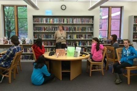Deborah Grimmett speaks with freshmen students during library orientation.