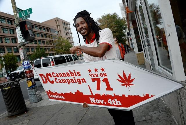 An+activist+from+the+D.C.+Cannabis+Campaign+holds+a+sign+during+the+midterm+elections+on+Tuesday%2C+Nov.+4%2C+2014%2C+in+Washington%2C+D.C.+++%28Olivier+Douliery%2FAbaca+Press%2FMCT%29