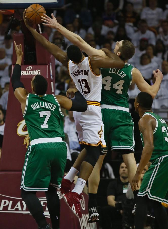 The Cleveland Cavaliers' Tristan Thompson (13) battles for a rebound with the Boston Celtics' Jared Sullinger (7) and Tyler Zeller (44) in the second quarter during Game 2 of the Eastern Conference quarterfinals at Quicken Loans Arena in Cleveland on Tuesday, April 21, 2015. The Cavs won, 99-91, for a 2-0 series lead. (Ed Suba Jr./Akron Beacon Journal/TNS)