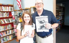 Amanda Martini was the lucky winner of the Green Wave Gazette Ticket Raffle. She won two  tickets to see Ed Sheeran perform at Gillette Stadium. Here she is accepting her tickets from GWG adviser, Mr. Dorman