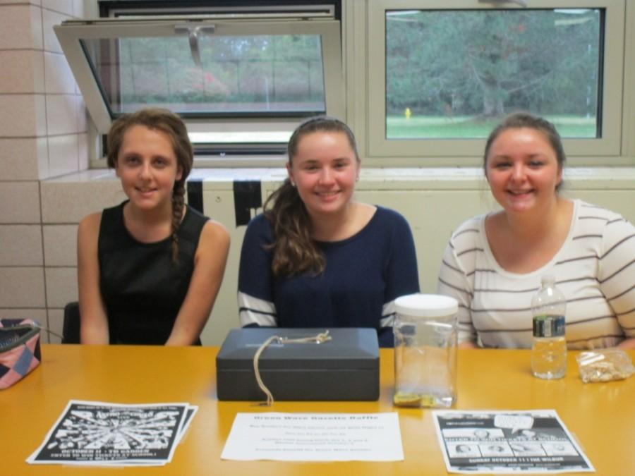 Staff members Katelyn LaRosa, Allison Dennehy and Alyssa Gendreau sell raffles at second lunch.