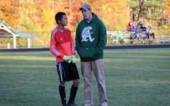 Coach McGinness talks things over with senior goalie Gregory Oreste