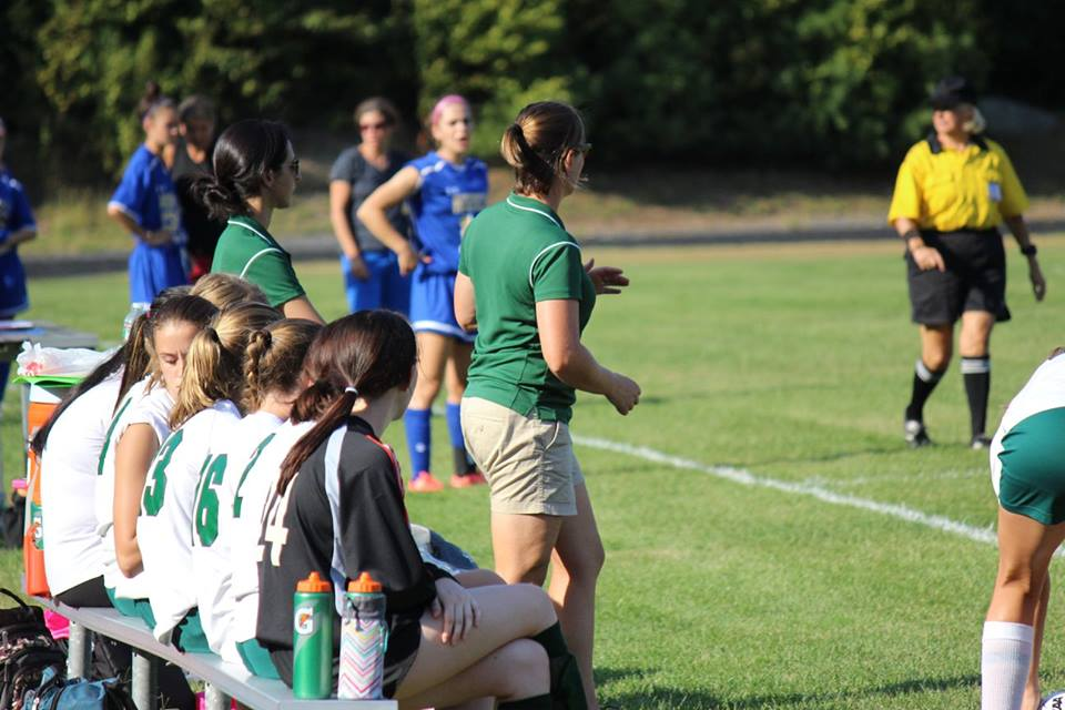 Coach Casey leading her team from the sidelines