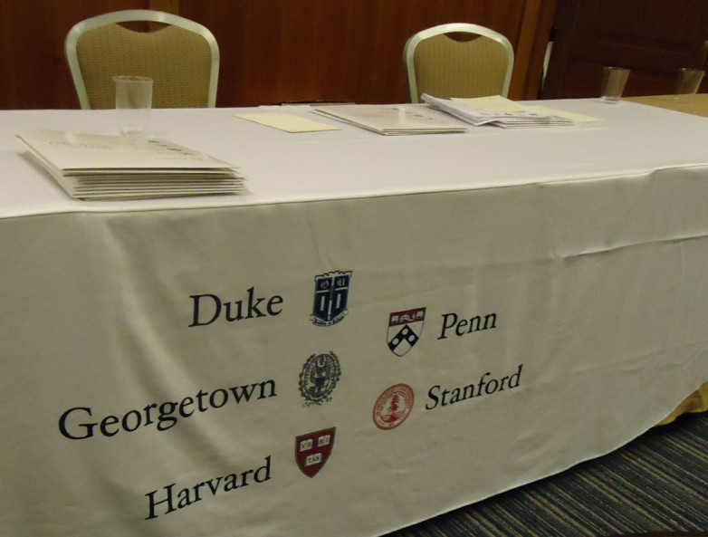 Table and banner at college admissions presentation.