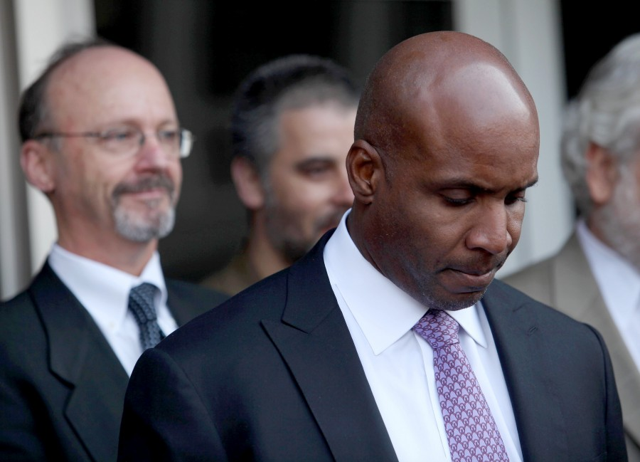 Former San Francisco Giants' Barry Bonds listens to lawyer Allen Ruby speak to the media on Wednesday, April 13, 2011 in San Francisco, California. Bonds was convicted on one count of obstruction of justice, and mistrial was declared on three counts of perjury, which was based on Bonds telling a grand jury in 2003 that he never used performance-enhancing drugs.  (Jane Tyska/Oakland Tribune/MCT)