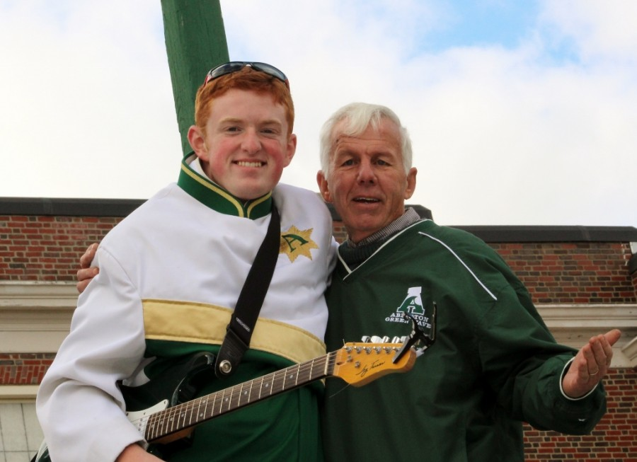 Mr. Bailey (r) with marching band member Joe Genest at a Green Wave football game last fall.