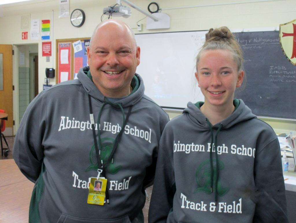 The author (Megan Reid) with Coach Lanner. Megan is a member of the girl's track team.