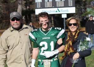 Dave and his proud parents on senior day.