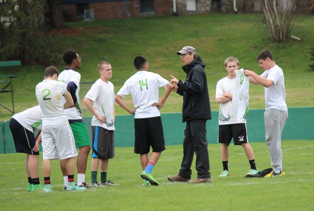 Coach Scott discusses strategy with the team. (Debra Herron Quinn courtesy of the Green Wave Boosters)