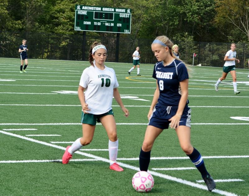 Madison Grafton guards a Cohasset defender from advancing the ball from Green Wave offensive zone.