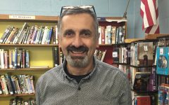 Art Director Mr. Di Rado, standing in the Abington High School Library Media Center in November of 2016.