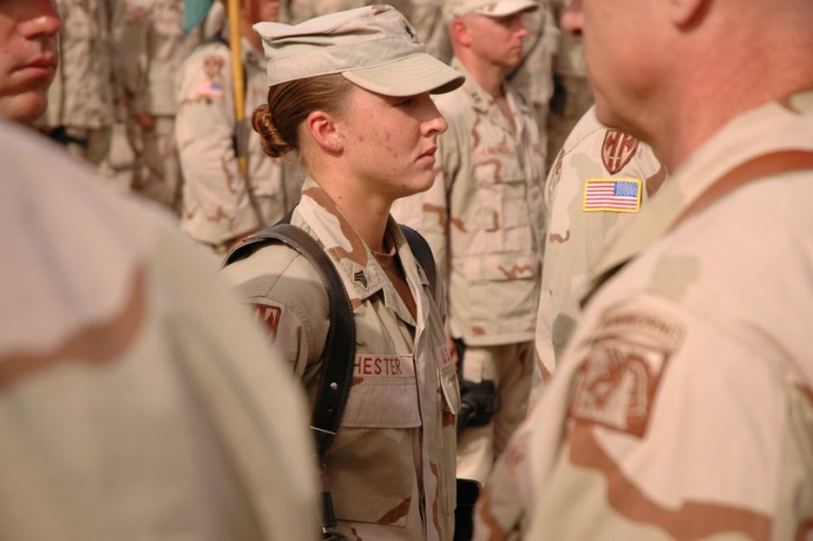 Sergeant Leigh Ann Hester, a United States Army soldier, waits to be awarded the Silver Star medal during a military awards ceremony at Camp Liberty, Iraq, on June 16, 2005. U.S. Army photograph by Jeremy D. Crisp.