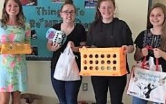 Ms. Gerhart, Advisor of Student Council, and Green Wave Gazette members Kathryn Genest,  Arianna Akusis, and Abby Joyce, all freshmen, pose with some of the items collected this month during a fundraiser for the pets displaced in Houston due as a result of Hurricane Harvey   that hit in early September
