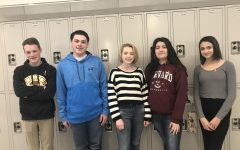 Freshmen Nick Graf, Matt Lyons, Madelyn O'Leary, Leticia Meneghetti, and Amanda Lopes wear orange ribbons in support of those in Parkland, FL