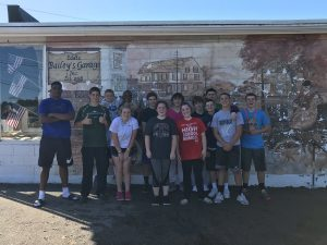 Car Wash volunteers from the Class of 2020 at Baileys Garage, May 2018. Left to right Jarib Cole, Will Klein, Steve Pizzi, Mikaela Littman, Jarae Cole, Colby Chryssicas, Victoria Donahue, Rob Stephens, Grace O'Donnell, Tom Furness, Bubba Gendreau, Leo Magnasco, Colby Augusta, Jake Bennett.
