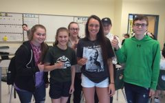 Green Wave Gazette members Abby, Elizabeth, Kathryn, Arianna, and Andrew present Marissa Golden with her raffle prize: free Taylor Swift tix