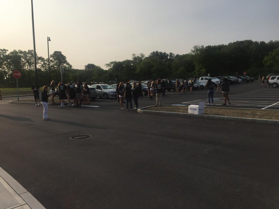 Members of the Class of 2018 gather in the parking lot before school