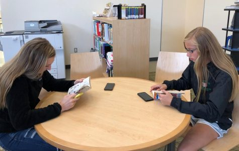 Freshmen Brooke Barry and Kaylee Carver Reading in the AHS Library