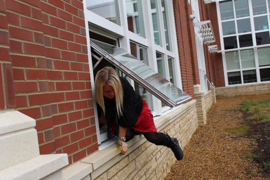 Mrs. O'Donnell escapes through a science class window.
