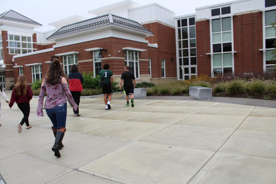 Students and staff head back into the school after drill.