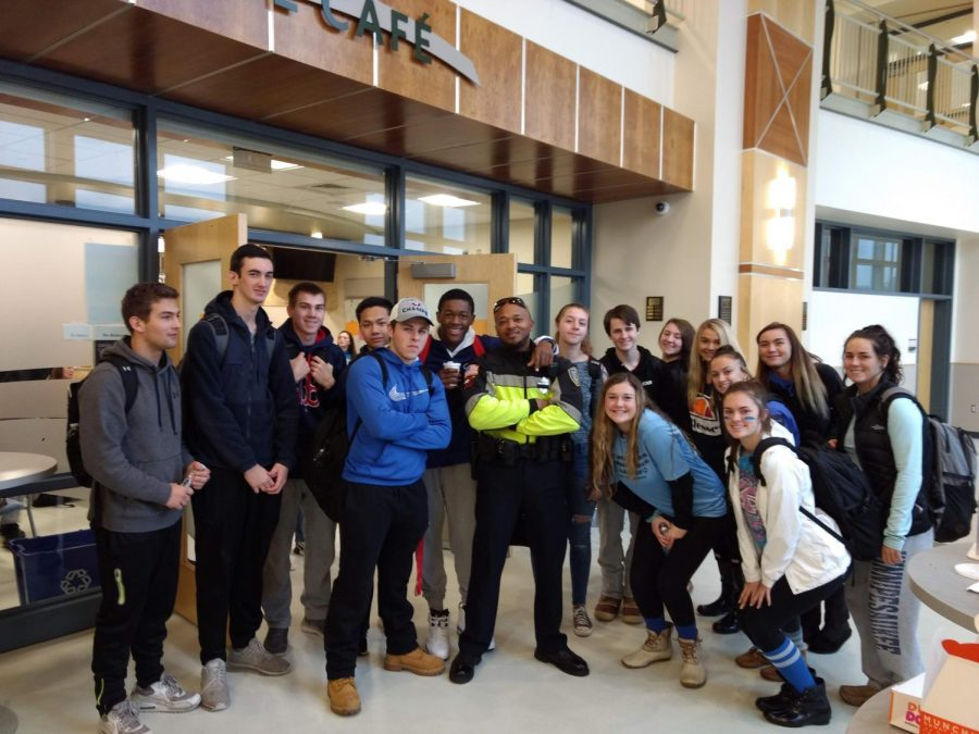 SRO Lynch surrounded by appreciative students during Blue Wave Day