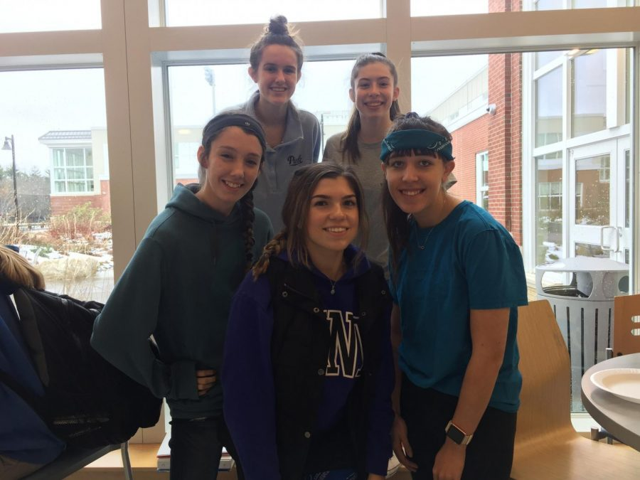 Students dress in blue for APD Day. (Back left to right) Juniors Sophia Villano and Erin McDermott. (Front left to right) Jessica Brundage '19, Manda Riddick '20 and Haley Grimard '19