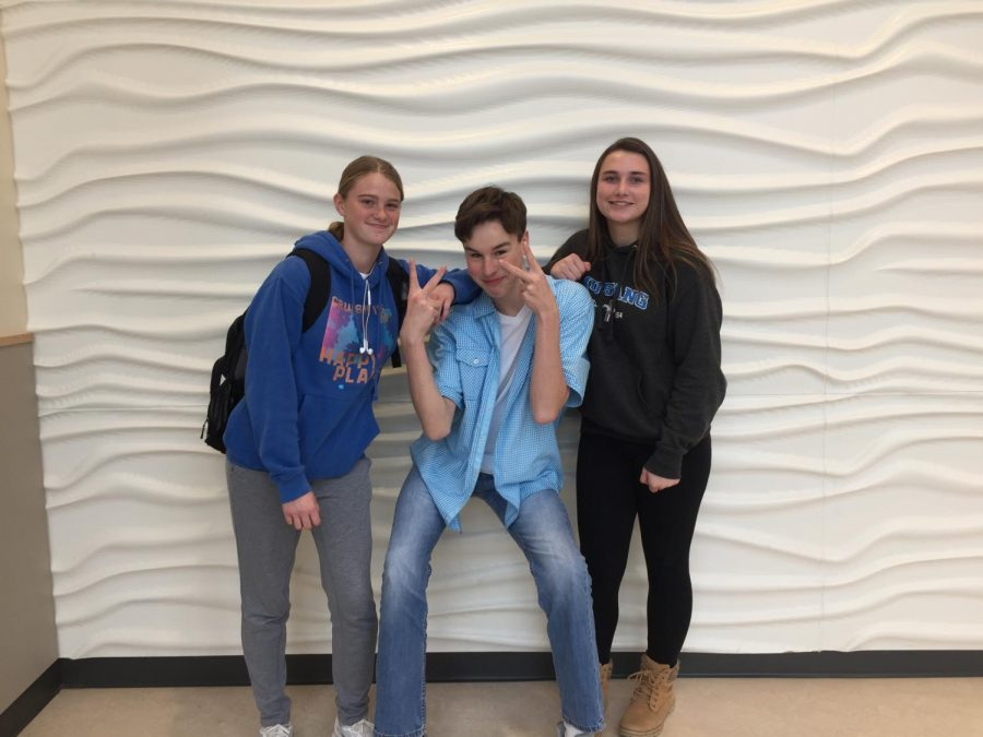 Sophomores Vicky Seppala, Aiden Fisher, and Allison Walsh wear blue for APD Day