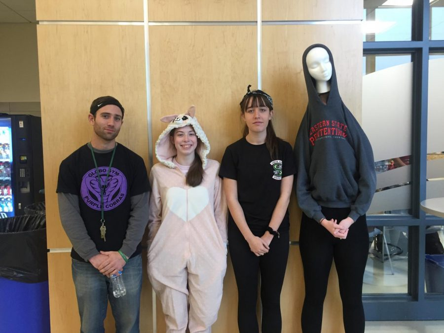 Students and staff dress up for character day featuring from left to right Mr. DiPrizio, Juniors Erin McDermott, Manda Riddick, and Sophia Villano.