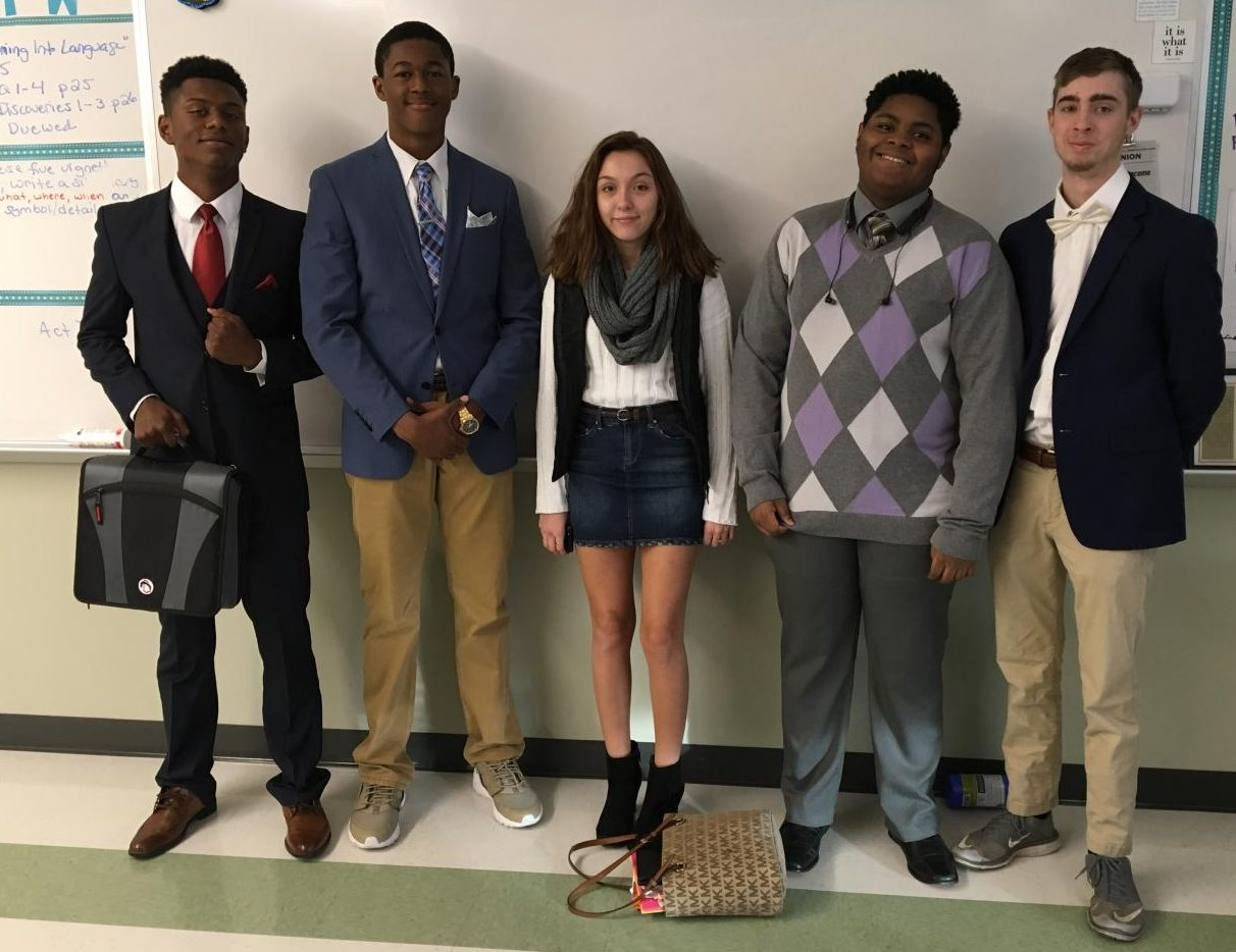 Classy students: seniors Josiah Rosa, Bryson Andrews, Chris Jean, and Justin Maskell stand with junior Kaitlyn Dosenberg