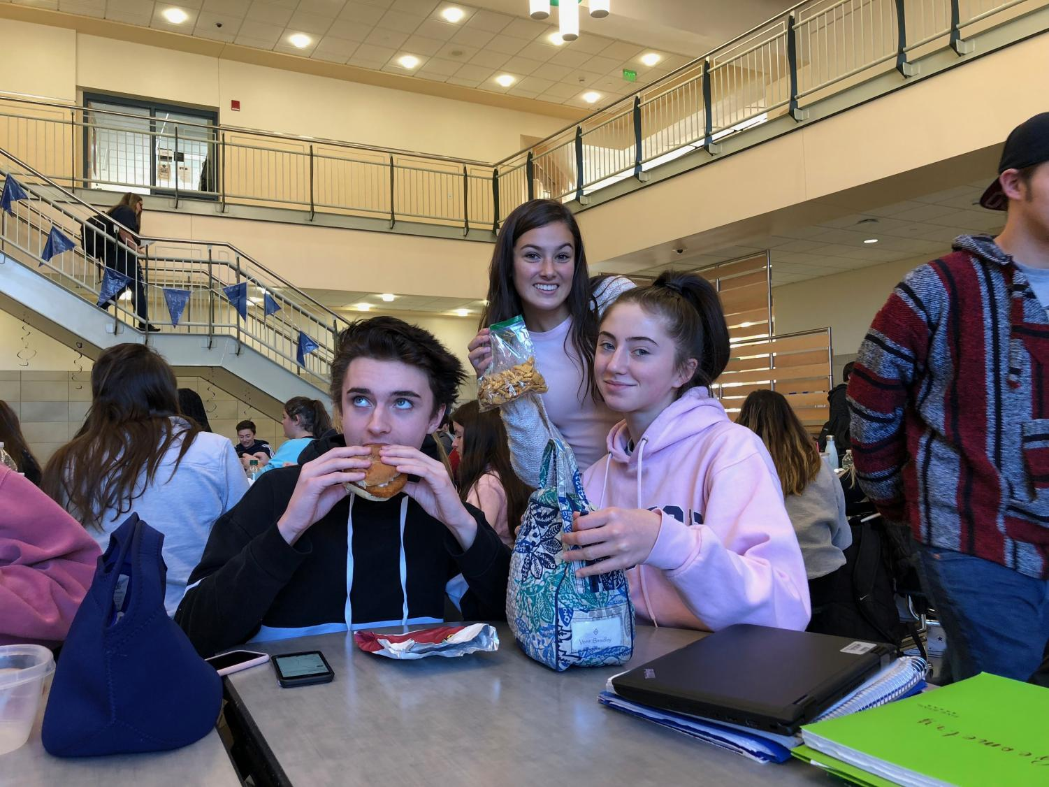 Jason Dole '21 enjoying cafeteria lunch, alongside classmates Lyla Blanchard and Aleena Magnasco