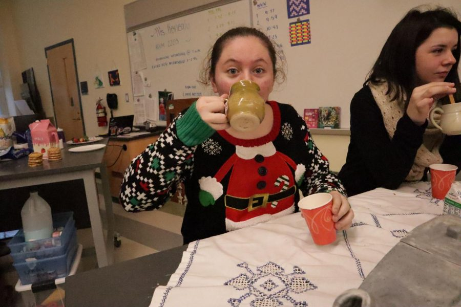 Sophomore Brandi Rix enjoying some tea at the holiday party in sculpture class.