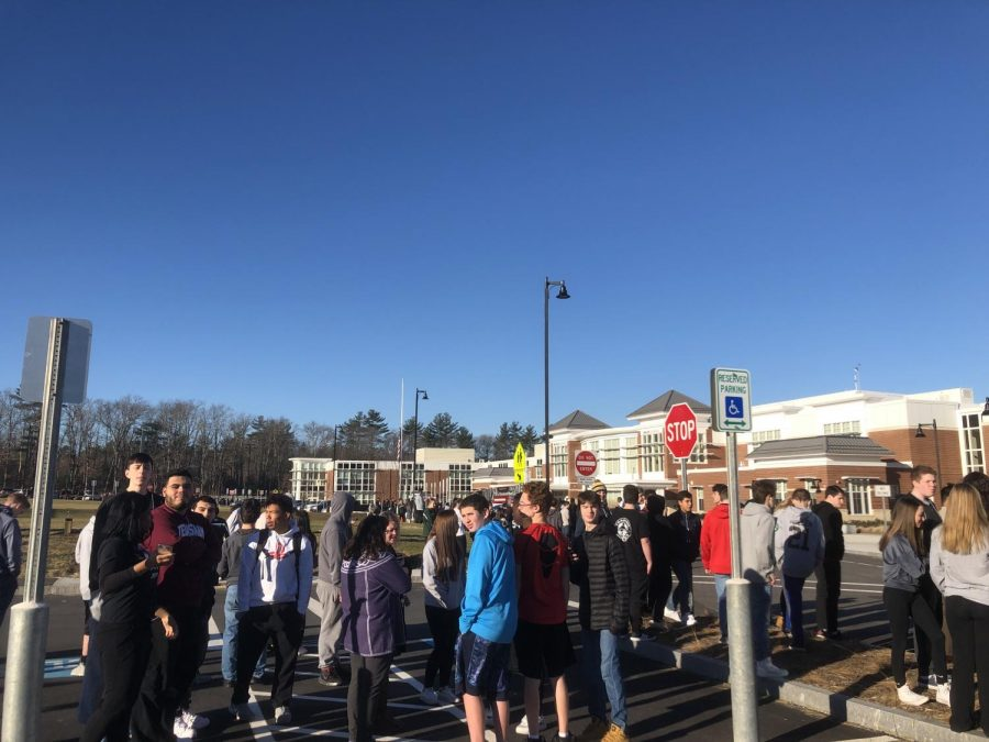 Abington High School tudents brave the cold as they wait for the all clear signal from administration.