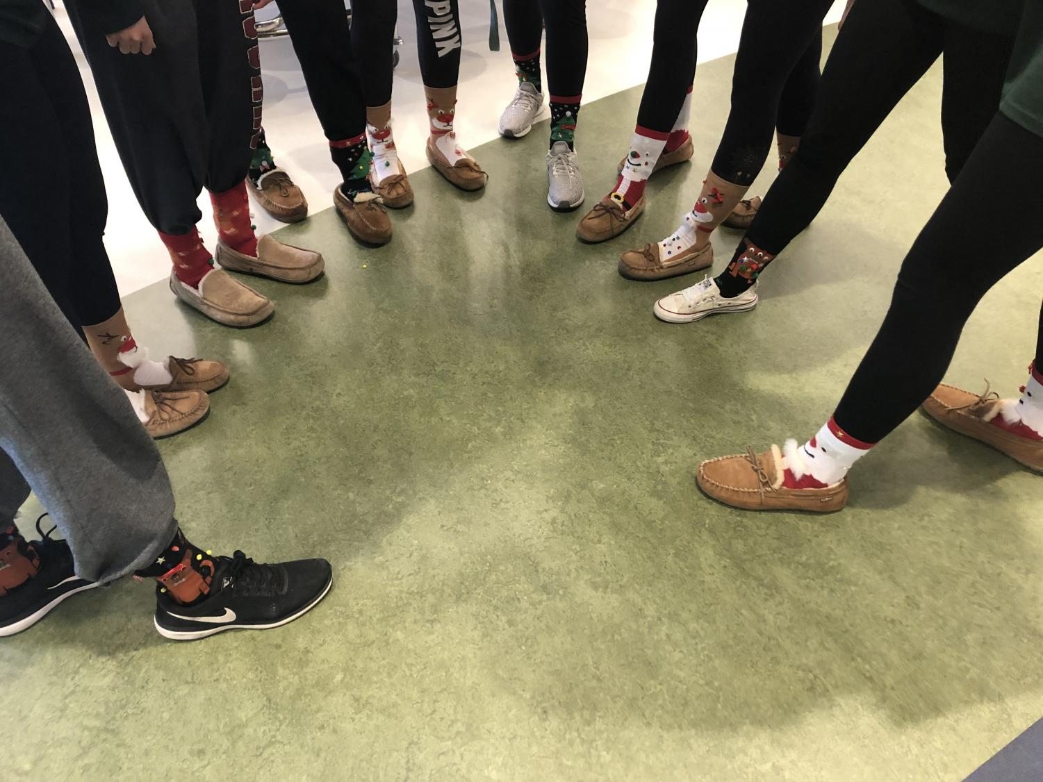 To kick off the first day of their winter season, AHS Girls Varsity Basketball Team all wore ugly socks to school on Dec. 11.
