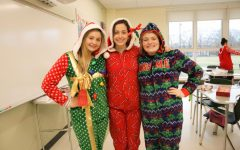 Juniors Kerry Cardinal, Izzy Miele, and Mikayla Littman decked out in festive onesies on Friday before the winter break.