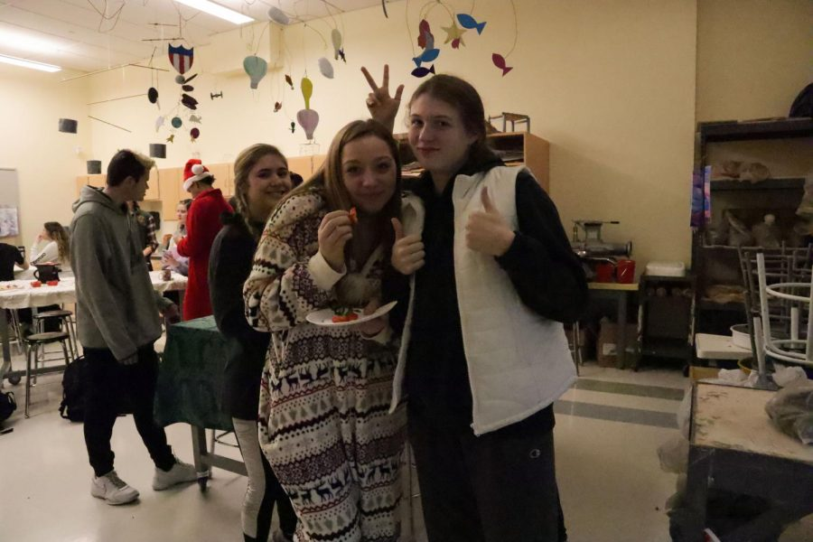 Senior Haven DiMambro, looks on as juniors Seana Phillips and Meagan McCadden pose with a thumbs up, excited for the holiday season!
