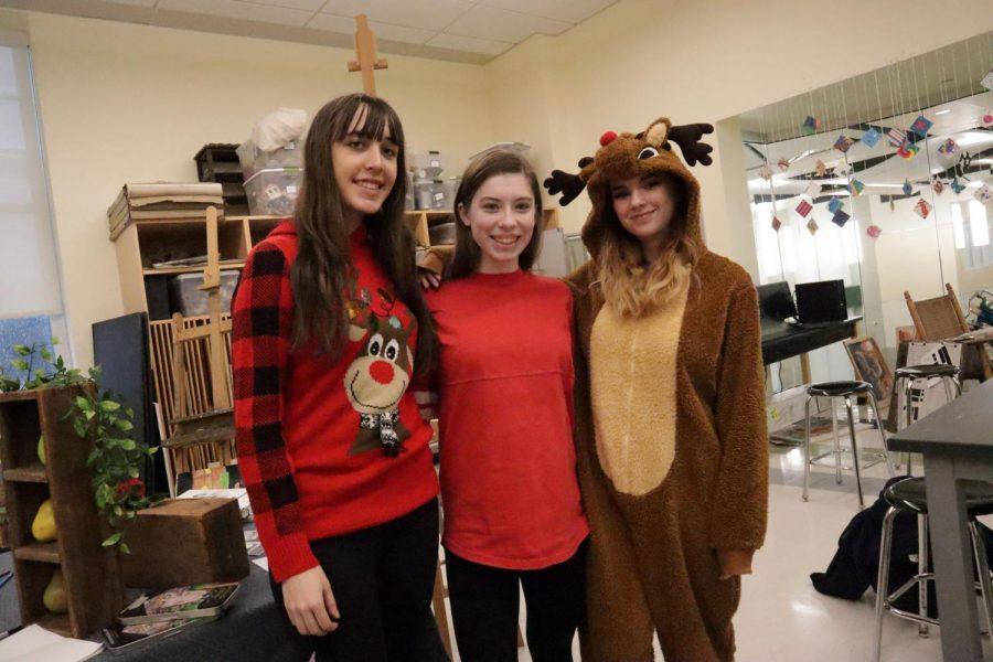 Juniors like Manda Riddick and Erin McDermott and senior Sarah St. John dress festively for the last day of school before the winter break.