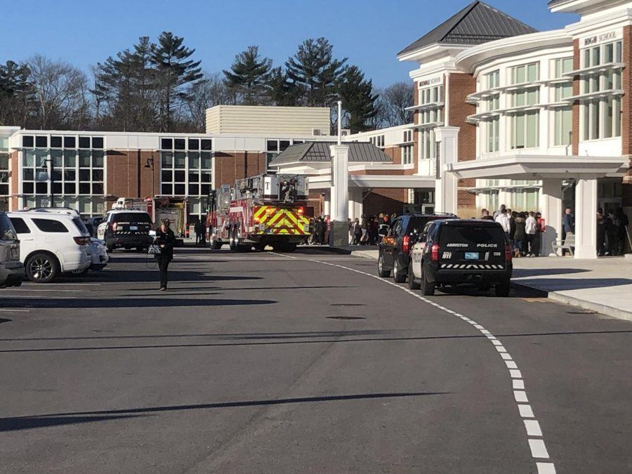 The Abington fire and police departments responding to an alarm at the co-located school