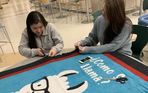 Seniors Amanda Nguyen and Christina Varney put together an Annie's Kindness Blanket during a blanket making event at Abington High School on Jan. 24. Christina Varney and her sisters Angela and Mia, along with their great aunt Barbara Buckley, started the Kindness Campaign after the girls' mother Annie Varney, who suffered from severe depression, took her life in 2015.